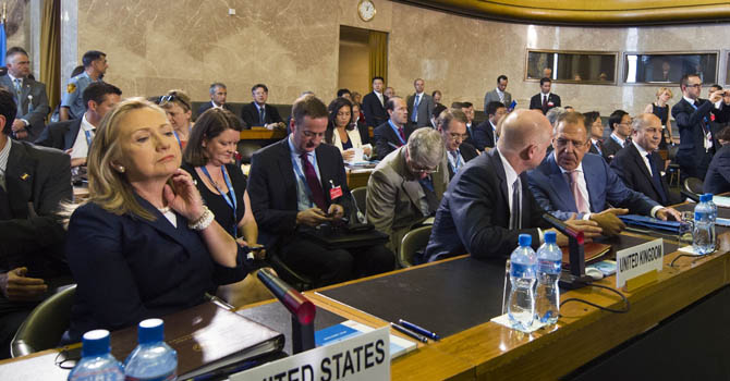 US Secretary of State Hillary Clinton (L) sits next to British Foreign Secretary William Hague (4th R), Russian Foreign Minister Sergei Lavrov (3rd R), and French Foreign Minister Laurent Fabius (2nd R) at the start of a crisis meeting on Syria at the United Nations office in Geneva, on June 30, 2012. World powers began a crisis meeting on Syria aimed at salvaging international envoy Kofi Annan's peace plan to end 16 months of bloodshed and chart a transition plan for the strife-torn country.  AFP
