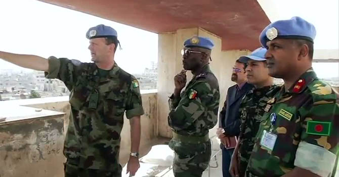 "An image grab taken from a video released by the United Nations Supervision Mission in Syria (UNSMIS) shows Senegalese Gen. Babacar Gaye (2nd L), the new head of the UN Supervision Mission in Syria, during a tour of the central Syrian city of Homs on July 29, 2012. In the central province of Homs, regime forces kept up their shelling of the rebel-held town of Rastan on July 30, 2012. ""AFP PHOTO / HO / UNSMIS  == RESTRICTED TO EDITORIAL USE - MANDATORY CREDIT ""AFP PHOTO / HO / UNSMIS"" - NO MARKETING NO ADVERTISING CAMPAIGNS - DISTRIBUTED AS A SERVICE TO CLIENTS - AFP IS USING PICTURES FROM ALTERNATIVE SOURCES AS IT WAS NOT AUTHORISED TO COVER THIS EVENT, THEREFORE IT IS NOT RESPONSIBLE FOR"