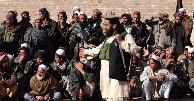 "Taliban militants gather in the Bara region of Pakistani tribal areas. Taliban have warned health workers administering polio vaccine to stop their campaigns or ""face the consequences."" – File photo by Dawn"