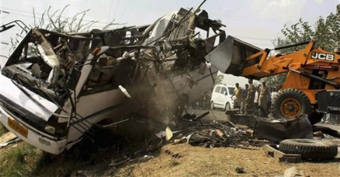 The wreckage of a passenger bus.—AP Photo