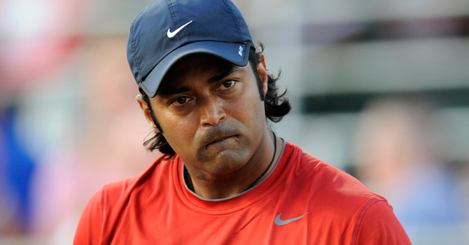 Washington Kastles' Leander Paes reacts during a World TeamTennis mixed doubles match against the New York Sportimes.—AP Photo