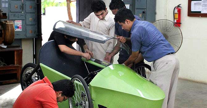 Students from NED University work on their ethanol-based car. – Photo courtesy team members