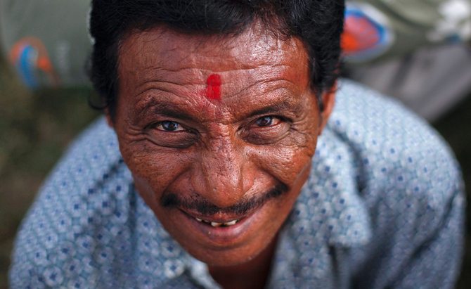 1)	Samzi, 50, an Indian fisherman spotting a Sindoor, made of vermillion powder, on his forehead, smiles as he waits in line at a prison in Karachi August 15, 2012. Pakistan today freed 55 Indian fishermen, who were imprisoned for illegally venturing into the country's territorial waters, from a jail in Karachi, as a gesture of goodwill on the occasion of India's Independence Day, a prison official said. Sindoor is considered to be very auspicious by Indians and used on special occasions like wedding and festivals.