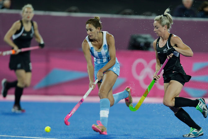 Argentina's captain Luciana Aymar runs with the ball during a women's hockey preliminary round match against New Zealand, at the 2012 Summer Olympics, Thursday, Aug. 2, 2012, in London. ? Photo by AP