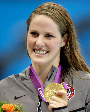 United States' Missy Franklin poses with her gold medal after her win in the women's 200-meter freestyle swimming semifinal at the Aquatics Centre in the Olympic Park during the 2012 Summer Olympics in London, Monday, July 30, 2012. ? Photo by AP