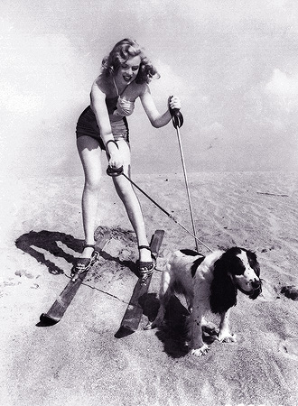 In this January 1, 1947 file photo, starlet Marilyn Monroe plays at the beach with her dog Ruffles. — AP Photo