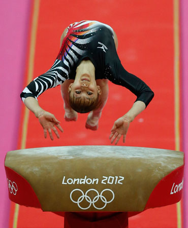 Japanese gymnast Rie Tanaka performs on the vault during the artistic gymnastics women's individual all-around competition final at the 2012 Summer Olympics, Thursday, Aug. 2, 2012, in London. ? Photo by AP