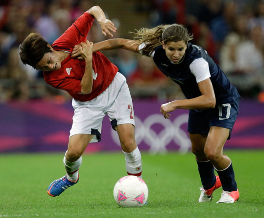 Japan's Yukari Kinga and United States' Tobin Heath battle for the ball during the women's soccer gold medal match at the 2012 Summer Olympics, Thursday, Aug. 9, 2012, in London.