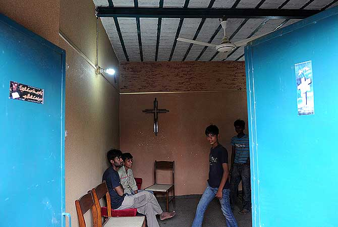 In a picture taken on on August 22, 2012, Pakistani Christian youth gather in a prayer room in the low-income neighbourhood of Mehrabad in the suburb of the capital Islamabad. — AFP Photo