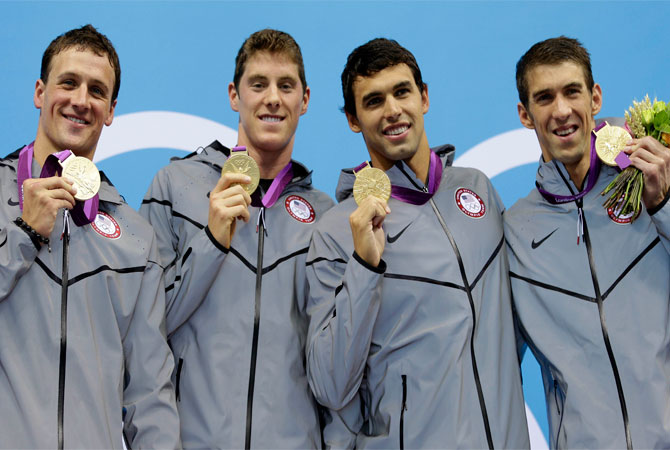 From left, United States' Ryan Lochte, United States' Conor Dwyer, United States' Ricky Berens, and United States' Michael Phelps pose with their gold medals for the men's 4x200-meter freestyle relay swimming final at the Aquatics Centre in the Olympic Park during the 2012 Summer Olympics in London, Tuesday, July 31, 2012. ? Photo by AP