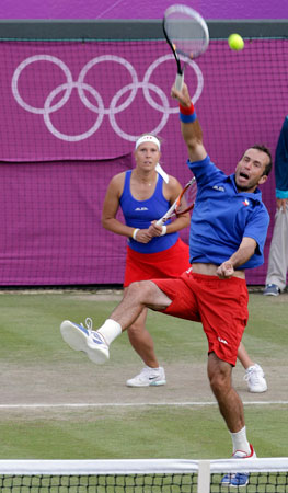 Radek Stepanek, right, and Lucie Hradecka, of the Czech Republic, play a mixed doubles match against Laura Robson and Andy Murray of Great Britain at the All England Lawn Tennis Club at Wimbledon, in London, at the 2012 Summer Olympics, Thursday, Aug. 2, 2012. ? Photo by AP