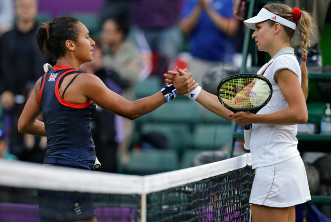 Maria Kirilenko of Russia, right, is congratulated by Heather Watson of Great Britain, left, after Kirilenko won their match at the All England Lawn Tennis Club at Wimbledon, in London, at the 2012 Summer Olympics, Tuesday, July 31, 2012. ? Photo by AP