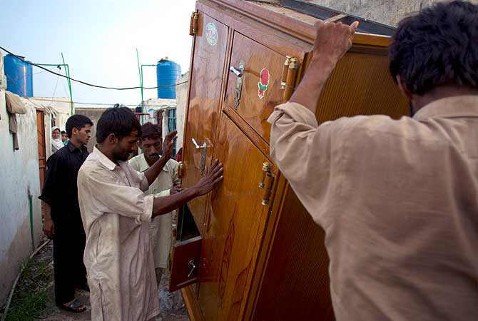 Frightened Pakistani Christian families flee their home in a suburb of Islamabad, Pakistan on Thursday, Aug. 23, 2012. — AP Photo