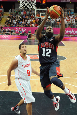 Tunisian forward Mohamed Hadidane, left, vies for the ball with the United States' guard James Harden during their men's preliminary round group A basketball match at the 2012 Summer Olympics on Tuesday, July 31, 2012, in London. ? Photo by AP