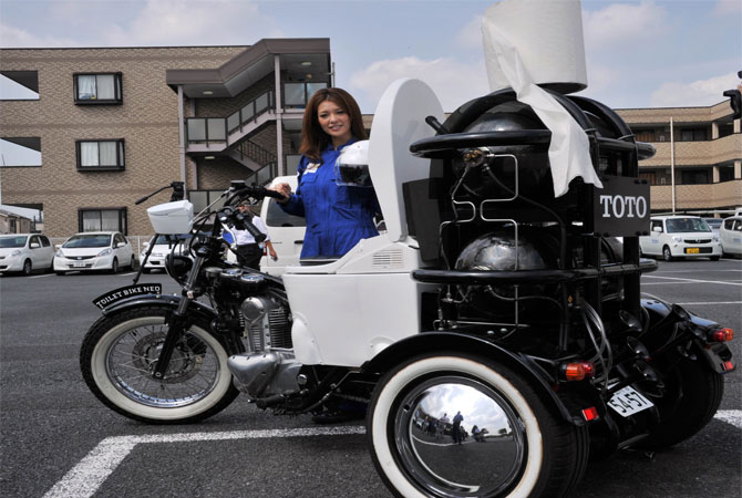 Toto made a demonstration of a Toilet Bike, a motorcycle equipped with a toilet bowl which moves on biogas that are, not made from a driver's waste but from livestock'.