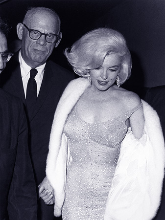 In this May 19, 1962 publicity photo provided by Running Press, actress Marilyn Monroe, right, arrives at Madison Square Garden to perform at a 45th birthday gala for President John F. Kennedy, in New York. She is escorted by her former father in law, Isidore Miller. — AP Photo