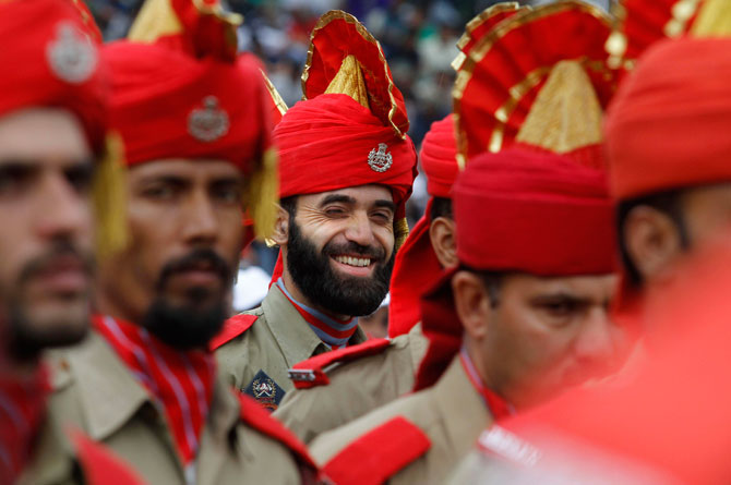 A Jammu and Kashmir policeman smiles as he joins his colleagues during a march on the occasion of 65th anniversary of India's independence from British rule, in Srinagar, India, Wednesday, Aug. 15, 2012. Photo by: AP