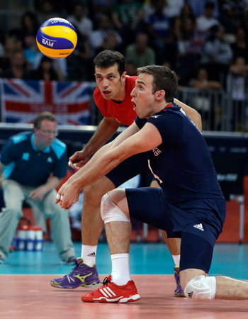 Britain's Daniel Hunter, front, handles the ball as teammate Andrew Pink watches during a men's preliminary volleyball match against Italy at the 2012 Summer Olympics, Thursday, Aug. 2, 2012, in London. ? Photo by AP
