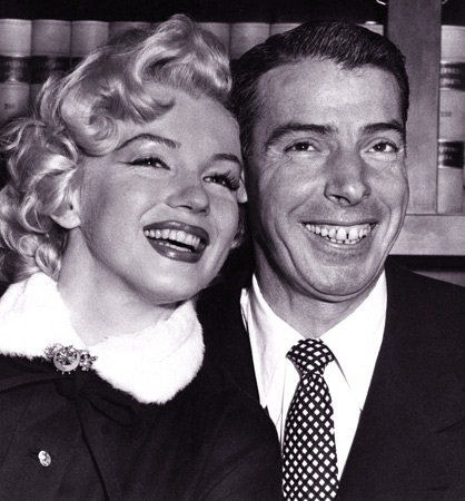 "In this Jan. 14, 1954 file photo, Joe DiMaggio baseball's famed ""Yankee Clipper,"" and screen actress Marilyn Monroe, smile cheek to cheek as they wait patiently in Judge Charles Perry's chambers for their marriage ceremony in San Francisco. The wedding climaxed a romance of more than a year. — AP Photo"