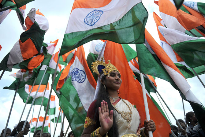 4)	An Indian woman dressed as Bharath Matha (Mother of India) poses with a tricolour flag during India's Independence Day celebrations in Secunderabad, the twin city of Hyderabad, on August 15, 2012. Manmohan Singh used his Independence Day speech to promise to improve conditions for foreign investment in the country after a sharp downturn in economic growth.  Photo by: AP