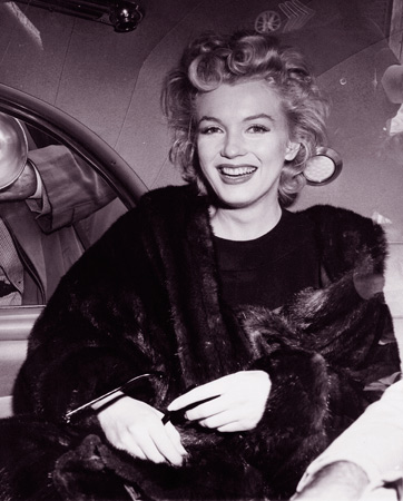 "- In this June 2, unknown year, file photo, actress Marilyn Monroe smiles in a car after arriving tousled from an all-night plane flight from Hollywood to Idlewild Airport, in New York. She said she planned to rest in New York before going to England to make a new movie with Sir Laurence Olivier. Sidestepping questions as to whether she and playwright Arthur Miller plan to wed, she said: ""No comment, we're really good friends."" — AP Photo"