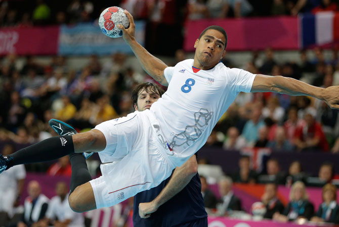 Daniel Narcisse of France scores during the men's handball preliminary match against Argentina at the 2012 Summer Olympics, Tuesday, July 31, 2012, in London. ? Photo by AP