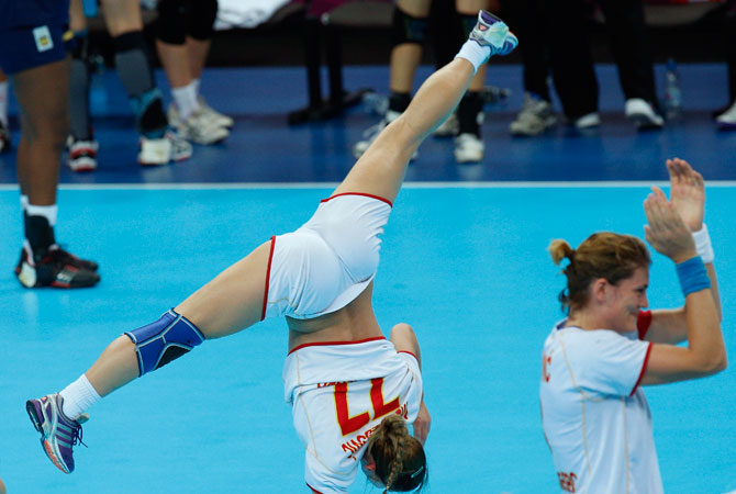 Montenegro players celebrate after defeating Spain in their women's handball semifinal match at the 2012 Summer Olympics, Thursday, Aug. 9, 2012, in London.