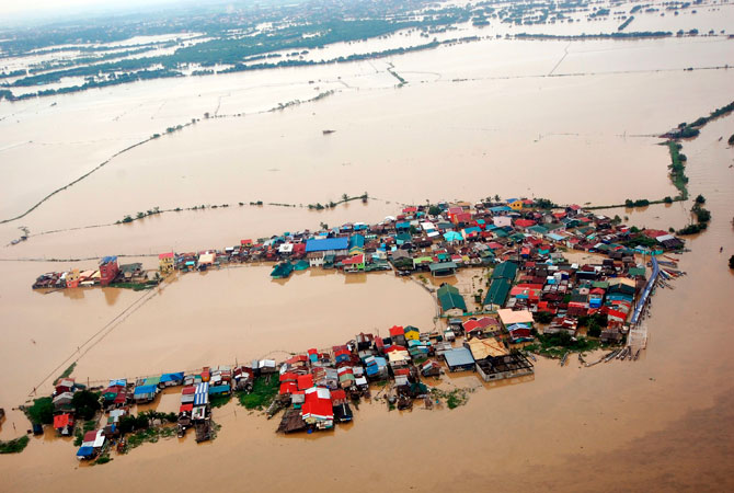 Houses swamped by floodwaters in Bulacan province, north of Manila is seen in this aerial photograph released by the Department of National Defense August 8, 2012. About 60 percent of Manila, a sprawling metropolis of about 12 million people, remained inundated on Wednesday, Benito Ramos, head of the national disaster agency. ? Photo by Reuters