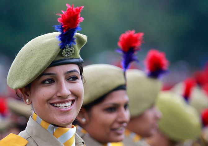 A member of the women's police contingent smiles at a parade during India's Independence Day celebrations in Srinagar on August 15, 2012. Photo by: Reuters