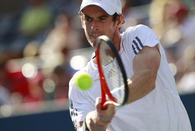 Britain's Andy Murray hits a return to Alex Bogomolov Jr. of Russia.