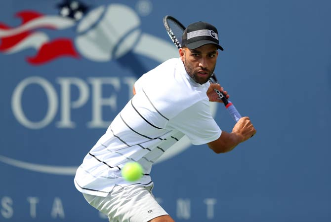 James Blake of the United States plays a backhand during his men's singles first round match against Lukas Lacko of Slovakia.