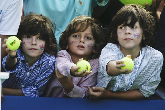 Young tennis fans wait to have their tennis balls signed by Andy Murray after he beat Bogomolov Jr.