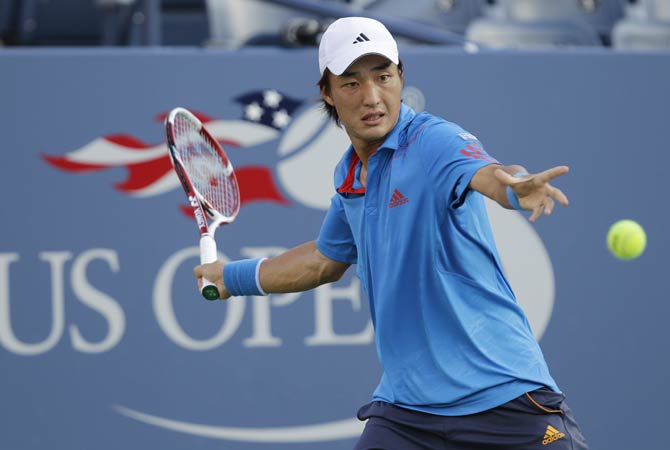 Go Soeda, of Japan, returns a shot to Mardy Fish.