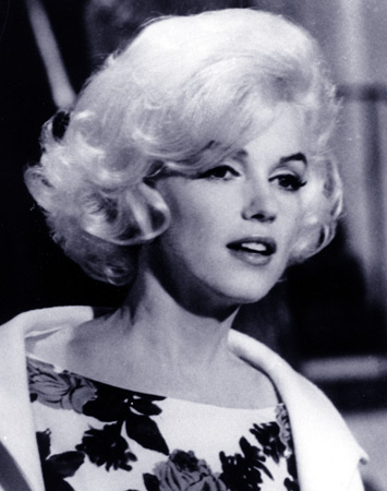 "In this April 1962 file photo, actress Marilyn Monroe is shown on the set of her last movie, ""Something's Got To Give,"" in Los Angeles.  Fifty years have not dimmed skeptics' suspicions about the death of Marilyn Monroe, but the intervening decades have seen technological leaps that could alter the investigation were it to occur today. — AP Photo"