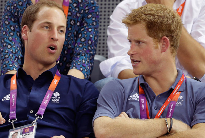 Britain's Prince William, left, and Prince Harry talk while watching track cycling at the velodrome during the 2012 Summer Olympics, Thursday, Aug. 2, 2012, in London. ? Photo by AP