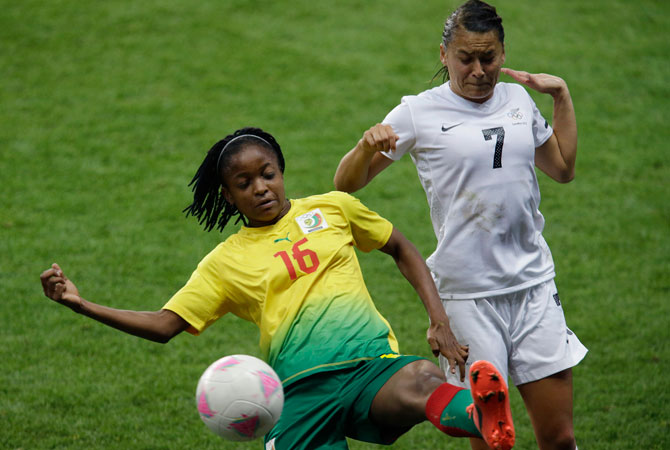 Cameroon's Reine Sosso, left, battles for the ball against New Zealand's Ali Riley during the group E women's soccer match between New Zealand and Cameroon at the London 2012 Summer Olympics, in Coventry, England, Tuesday, July 31, 2012. ? Photo by AP