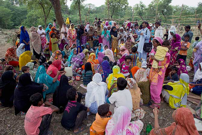 Pakistani Christians from a neighborhood where a girl was arrested on alleged blasphemy charges pray in a clearing of an urban forest in Islamabad. — AP Photo