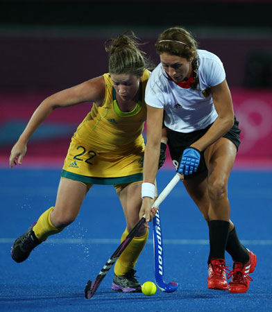 Australia's Kate Jenner, left, and Germany's Christina Schuetze vie for the ball during their women's hockey preliminary round match at the 2012 Summer Olympics, Tuesday, July 31, 2012, in London. ? Photo by AP