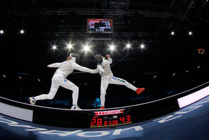 Italy's Valentina Vezzali (R) competes against Russia's Larisa Korobeynikova in the women's team foil fencing gold medal match at the ExCel arena during the London 2012 Olympic Games August 2, 2012. ? Photo by Reuters