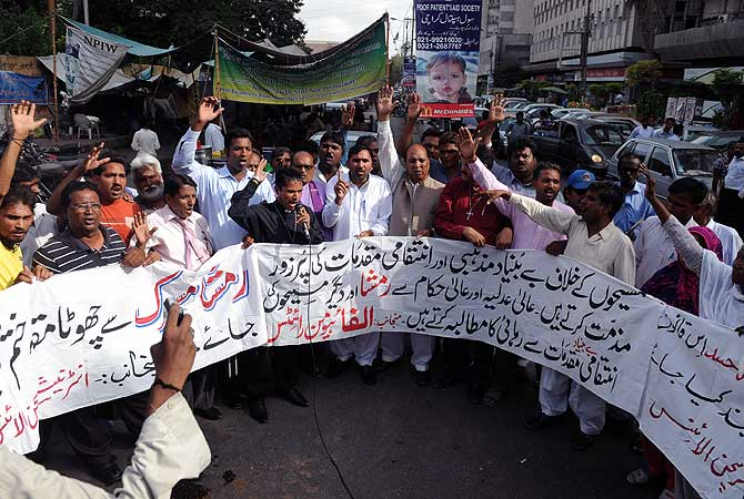Members of the International Christian Alliance chant slogans in support of a Christian girl who was accused of burning papers containing verses from the Quran, at a protest in Karachi on August 27, 2012. — AFP Photo