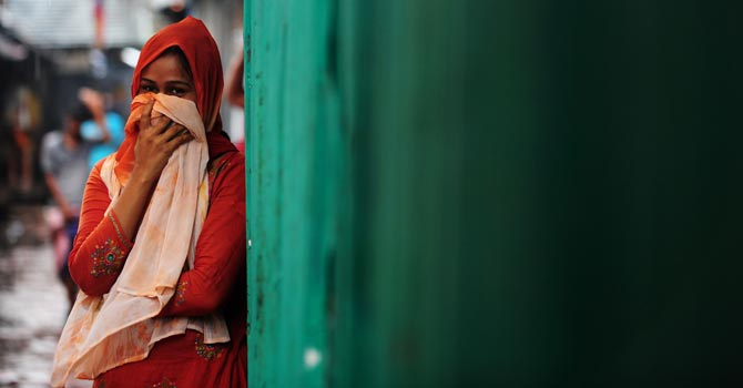 A Bangladeshi sex worker looks on at a brothel, in existence for at least a century, in Madaripur. — AFP Photo