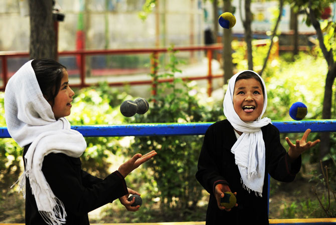 Afghan jugglers rehearse before the 7th Afghanistan Juggling Championships in Kabul on August 27, 2012.