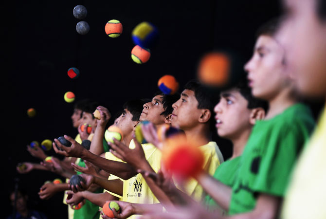 Jugglers perform during the 7th Afghanistan Juggling Championships in Kabul on August 27, 2012.
