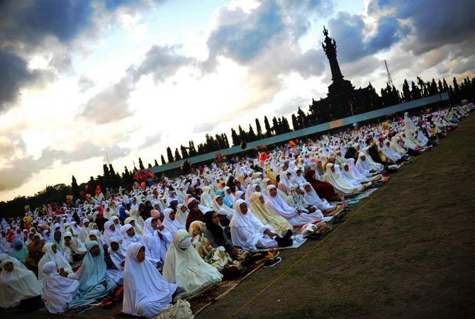 Indonesian Muslims attend prayer during Eid al-Fitr at Bajra Sandhi monument and park in Denpasar. - Photo by AFP