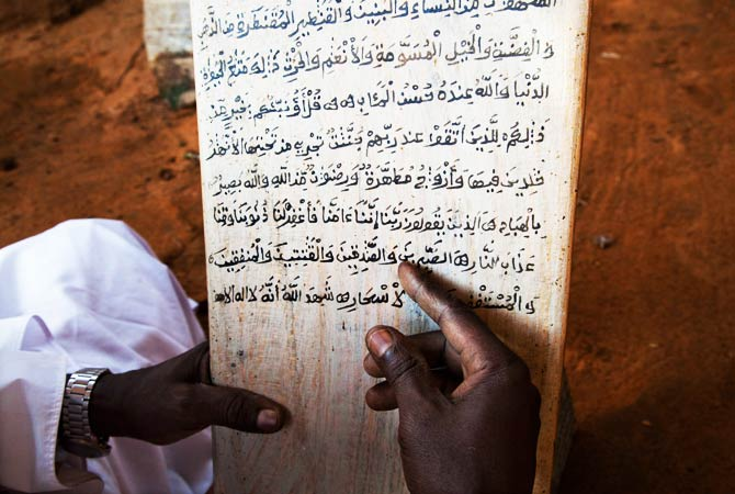 "Sidig Ahmad Mohamed, a ""Faki"" recites the Quran. ? Photo by AFP"
