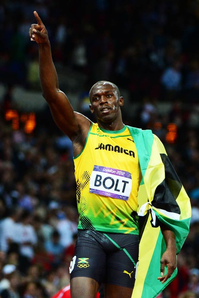 Jamaica's Usain Bolt celebrates after winning the men's 100m final at the athletics event. - Photo by AFP
