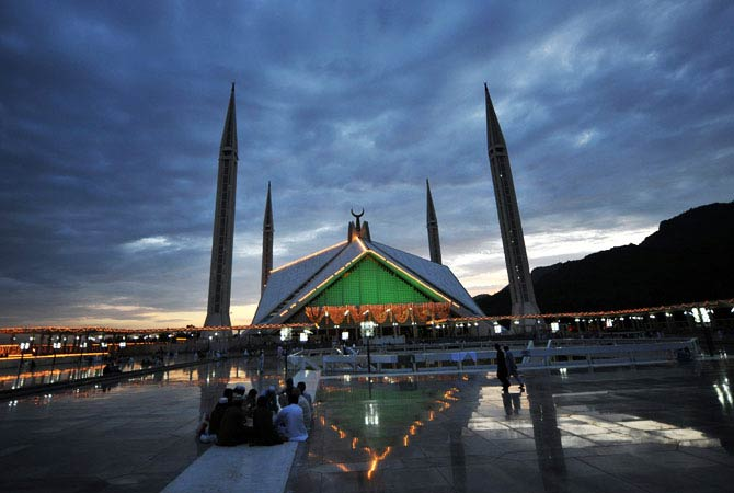 Pakistani Muslims break their fast at the grand Faisal Mosque. - Photo by AFP
