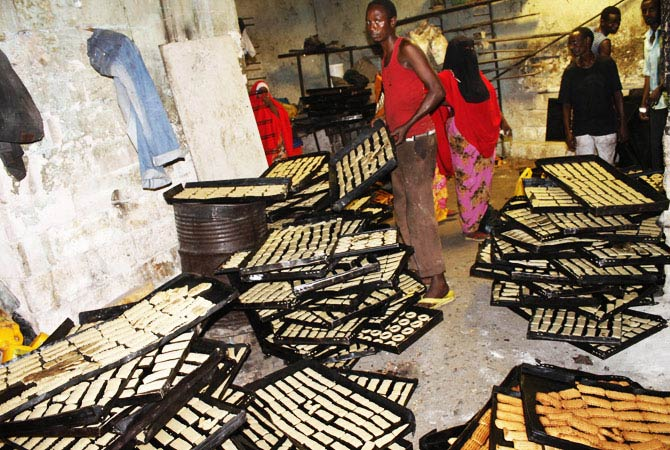 Somali bakery workers prepare biscuits in Mogadishu's Hamarweyne market on the eve of the Muslim Eid festival. - Photo by AFP