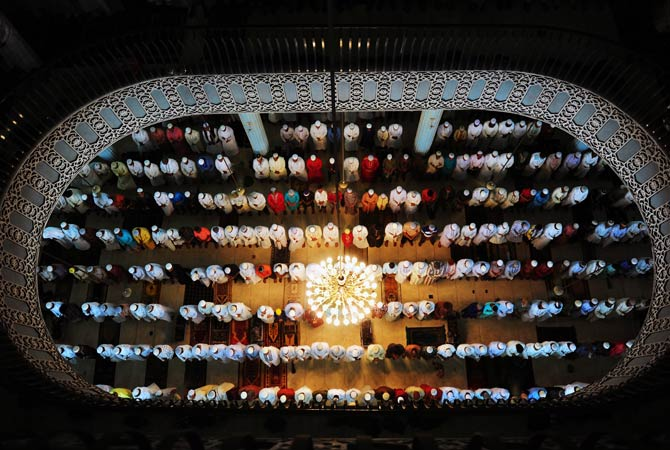 Bangladeshi Muslims offer Eid al-Fitr prayers at the National Mosque of Bangladesh, Baitul Mukarram in Dhaka. - Photo by AFP