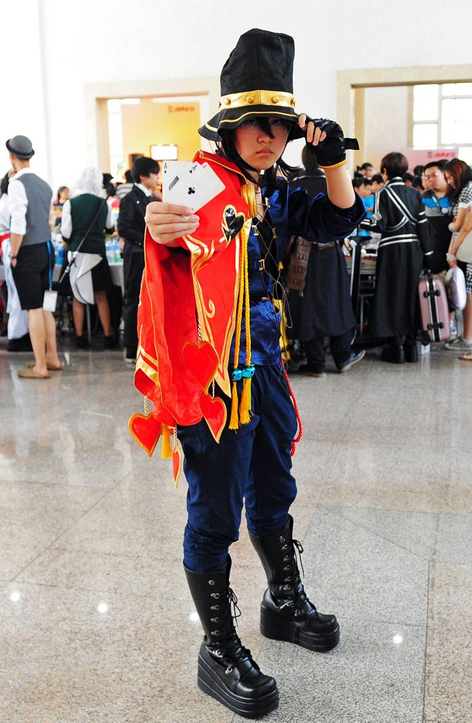 A cosplay fan poses in character. - Photo by AFP